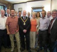 Mayor with group of business people