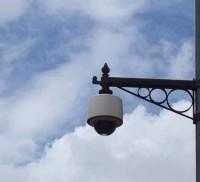 CCTV camera on decorative bracket. Blue sky and white clouds. © Farnham Town Council