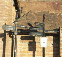 Two black signposts