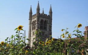 Church with sunflowers in front.