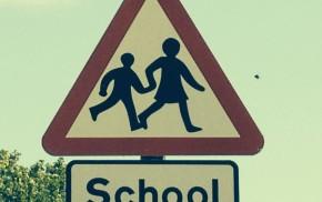 Triangular school warning sign