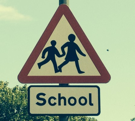 Triangular school warning sign
