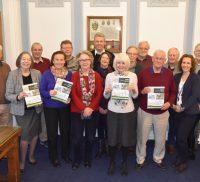 Group of people holding copies of the Farnham Neighbourhood Plan