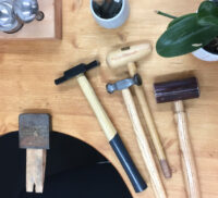 Various hand tools on a table top